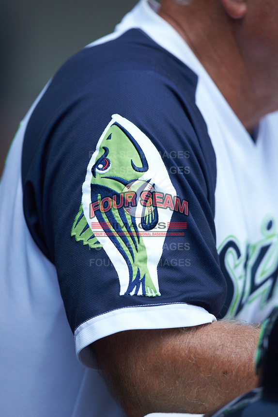 A close-up of the Striper fish emblem on the sleeve of the Gwinnett Stripers jersey during the game against the Scranton/Wilkes-Barre RailRiders at Coolray Field on August 18, 2019 in Lawrenceville, Georgia. The RailRiders defeated the Stripers 9-3. (Brian Westerholt/Four Seam Images)