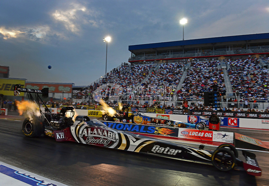 Sept. 16, 2012; Concord, NC, USA: NHRA top fuel dragster driver Shawn Langdon (near) races alongside Brandon Bernstein during the O'Reilly Auto Parts Nationals at zMax Dragway. Mandatory Credit: Mark J. Rebilas-
