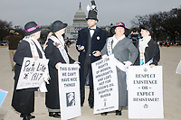 "A man dressed as Abraham Lincoln with a small protest sign reading ""Kiss my Trump"" poses for pictures at the end of the day after people gathered in the National Mall area of Washington, DC, for the Women's March on Washington protest and demonstration in opposition to newly inaugurated President Donald Trump on Jan. 21, 2017."