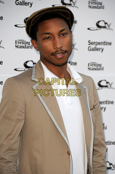 PHARRELL WILLIAMS .The Summer Party at The Serpentine Gallery, London, England. .July 9th, 2009 .half length brown beige jacket flat cap hat .CAP/CAS.©Bob Cass/Capital Pictures.