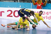 Spain's Viran Morros (c) and Australia's Martin Najdovski (l) and Daniel Kelly during 23rd Men's Handball World Championship preliminary round match.January 15,2013. (ALTERPHOTOS/Acero) /NortePhoto