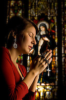 A young woman prays the rosary inside Belmont Abbey Basilica in Belmont, NC.
