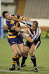 Simms Davison tries to wrench the ball free as he tackles Tevita Tuifua during the Air NZ Cup rugby game between Bay of Plenty & Counties Manukau played at Blue Chip Stadium, Mt Maunganui on 16th of September, 2006. Bay of Plenty won 38 - 11.