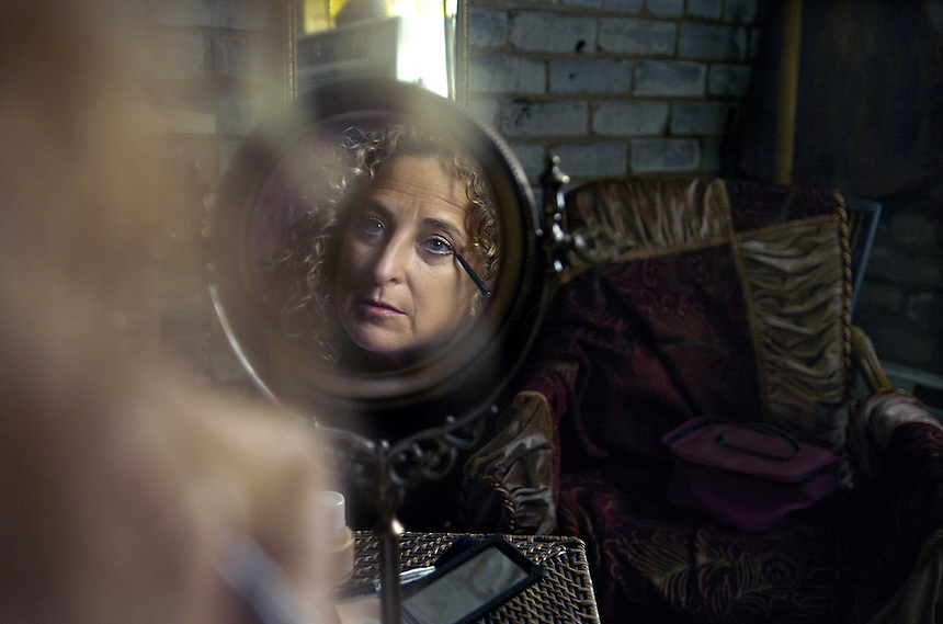 "Former Chicagoan and now resident of Three Oaks, Donna Blue Lachman applies makeup in her dressing room before performing her one act play, ""On Death and Gardening""."
