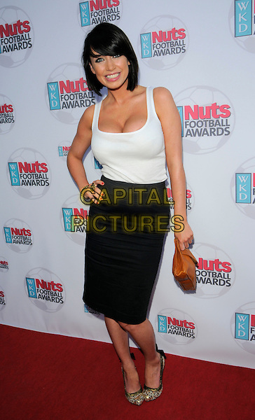 SOPHIE HOWARD.At the WDK Nuts Football Awards,.Cafe De Paris, London, England, UK,.May 7th 2008..full length black skirt white cream vest top hand on hip cleavage tucked in brown clutch bag purse gold shoes.CAP/CAN.©Can Nguyen/Capital Pictures