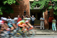 People take a break from work in Augusta, Ga. to watch the start of Stage 1 of the 2006 Ford Tour de Georgia pro cycling race. Lars Michaelsen of Team CSC won 129-mile stage from Augusta to Macon in 4:45:46.<br />