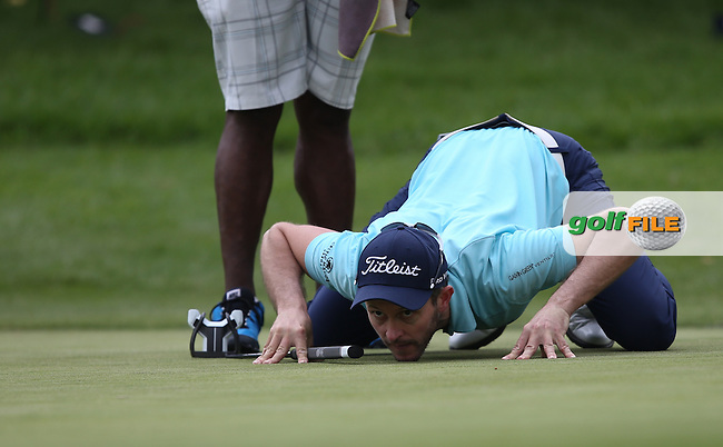 Stuart Manley (WAL) prepares to putt out on the last,  on the East Course during Round Three of the Joburg Open 2015 at the Royal Johannesburg & Kensington Golf Club, Johannesburg, Gauteng, South Africa. Picture:  David Lloyd / www.golffile.ie. 28/02/2015