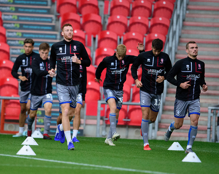 Lincoln City's Cian Bolger, left, and Harry Toffolo, right lead the warm up<br /> <br /> Photographer Andrew Vaughan/CameraSport<br /> <br /> EFL Leasing.com Trophy - Northern Section - Group H - Doncaster Rovers v Lincoln City - Tuesday 3rd September 2019 - Keepmoat Stadium - Doncaster<br />  <br /> World Copyright © 2018 CameraSport. All rights reserved. 43 Linden Ave. Countesthorpe. Leicester. England. LE8 5PG - Tel: +44 (0) 116 277 4147 - admin@camerasport.com - www.camerasport.com