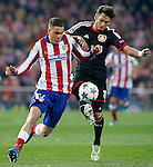 Atletico de Madrid's Jose Maria Gimenez (l) and Bayer 04 Leverkusen's Hakan Calhanoglu during Champions League 2014/2015 match.March 16,2015. (ALTERPHOTOS/Acero)