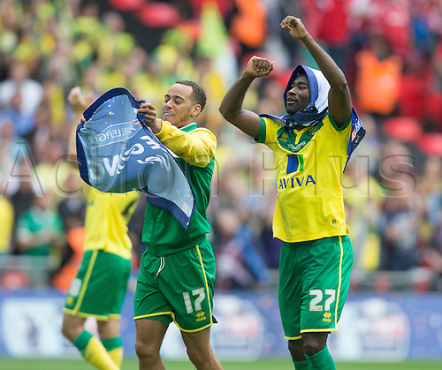 25.05.2015.  London, England. Skybet Championship Playoff Final. Middlesborough versus Norwich. Norwich City's Elliott Bennett and Alexander Tettey celebrate at the final whistle.