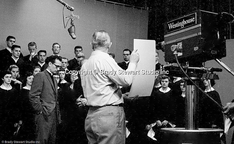 Pittsburgh PA:  First Lutheran church's Pastor Harold Albert conducting Sunday Services on KDKA television in 1958.  When Pastor Albert was chosen to lead the first English Evangelical Lutheran Church  in Pittsburgh, he promised a new vision for the downtown church.  Due to the ongoing exodus of city residents to the suburbs, the church needed change with the times.  The church hired a local advertising and Public Relations firm along with Brady Stewart Studio to better promote the church and to expand services.