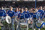 "A samba band dressed in Portsmouth colours entertaining the crowd at Fratton Park stadium before their club take on local rivals Southampton in a Championship fixture. Around 3000 away fans were taken directly to the game in a fleet of buses in a police operation known as the ""coach bubble"" to avoid the possibility of disorder between rival fans. The match ended in a one-all draw watched by a near capacity crowd of 19,879."