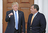 United States President-elect Donald Trump (L) gestures with New Jersey Governor Chris Christie at the clubhouse of Trump International Golf Club, in Bedminster Township, New Jersey, USA, 20 November 2016.<br /> Credit: Peter Foley / Pool via CNP