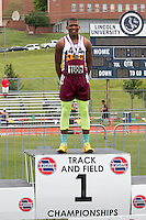 Kelly's Maurice Davis stands atop the awards podium after his victory in the Class 2 100-meter dash.