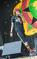 Dee-1 performs at the 2014 New Orleans Jazz and Heritage Festival in New Orleans, LA.