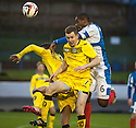 Cowdenbeath's Nathaniel Wedderburn heads clear from Queen of the South's Derek Lyle and Paul Burns.