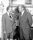 "Washington, D.C. - May 20, 1977 -- United States President Jimmy Carter, left, and former United States President Gerald R. Ford, right, share some thoughts in the Oval Office in the White House in Washington, D.C. on May 20, 1977.  Ford received a briefing during his visit..Credit: Benjamin E. ""Gene"" Forte - CNP"
