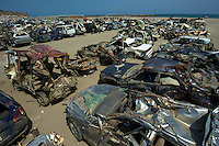 Debris that makes up most  of the town of Natori that was completely devastated during the March 11th Tsunami in Japan.  The small coastal town was swept away most of it ending up in the rice field a kilometer away.  Now 100 days after the tsunami most of the fields have been cleared of debris and the town has been cleared.  Next to the coast a huge pile of thousands of tonnes of debris, mounting to the entire village, is piled up on the coast, next to hundreds of mangles cars..16 May 2011..photo by Richard Jones  / Sinopix....