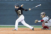 Shortstop Derek Hirsch (11) of the Wofford College Terriers bats in a game against the Boston College Eagles on Friday, February 13, 2015, at Russell C. King Field in Spartanburg, South Carolina. The BC catcher is Nick Sciortino. Wofford won, 8-4. (Tom Priddy/Four Seam Images)