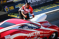 Sep 2, 2016; Clermont, IN, USA; Crew member with NHRA pro mod driver Harold Martin during qualifying for the US Nationals at Lucas Oil Raceway. Mandatory Credit: Mark J. Rebilas-USA TODAY Sports