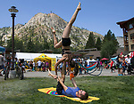 Ione Chan and Davide Di Censo perform acro yoga during Wanderlust at Squaw Valley on Saturday, July 21, 2018.