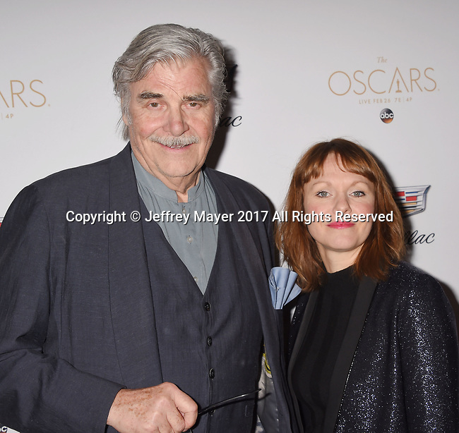 LOS ANGELES, CA - FEBRUARY 23: Actor Peter Simonischek (L) and director Maren Ade attend Cadillac's 89th annual Academy Awards celebration at Chateau Marmont on February 23, 2017 in Los Angeles, California.