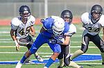 Culver City, CA 09/12/13 - unidentified Culver City player(s), Andrew Condon (Peninsula #45), Paxton Shive (Peninsula #24) and unidentified Peninsula player(s) in action during the Peninsula vs Culver City Junior Varsity game at Culver City High School.