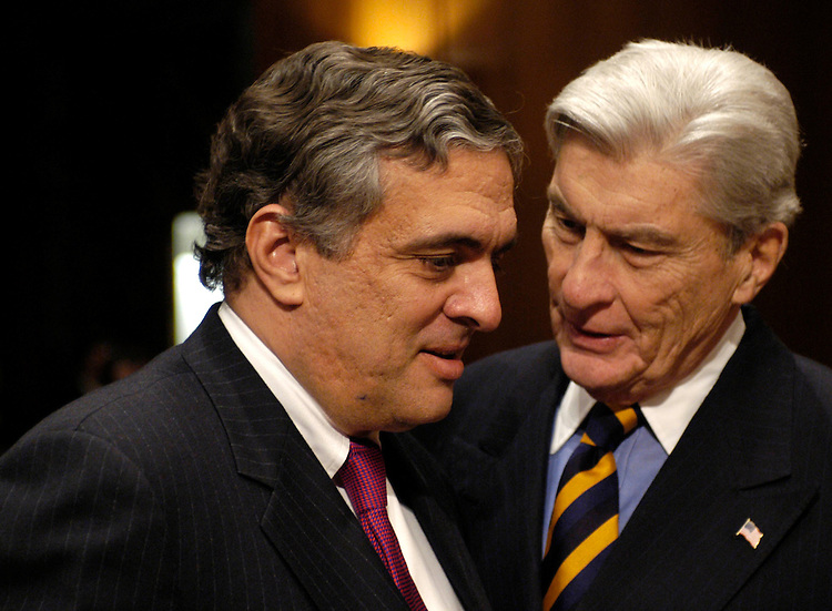 CIA Director George J. Tenet speaks with Sen. John Warner, R-Va., before testifying this morning before the Select Committee on Intelligence on worldwide threats.
