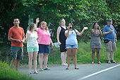 United States President Barack Obama's motorcade passes people waving on the side of the road, in Chilmark, Massachusetts  after arriving for his vacation at Martha's Vineyard Airport in West Tisbury, Massachusetts on August 18, 2011 ..Credit: Rick Friedman / Pool via CNP