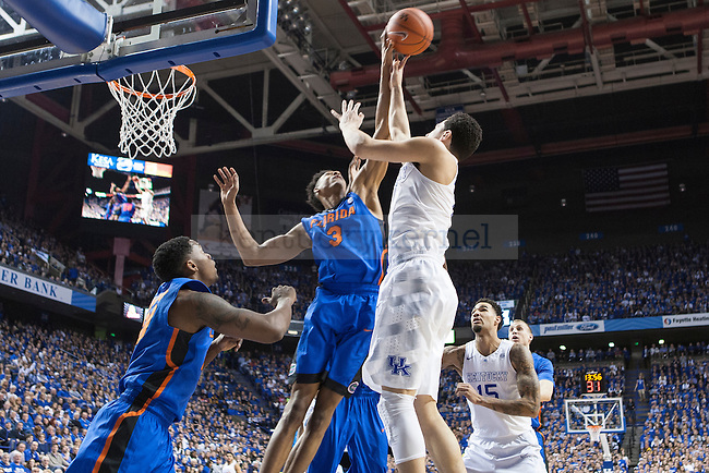 Guard Devin Booker of the Kentucky Wildcats is blocked by forward Devin Richardson during the game against the Florida Gators at Rupp Arena on Saturday, March 7, 2015 in Lexington, Ky. Kentucky leads Florida 30-27 at the half. Photo by Michael Reaves | Staff.
