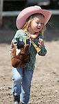 Fallon's Chloe Copeland rides her horse in the Pee-Wee Stick Horse Barrel race at the Fallon Junior Rodeo.  Photo by Tom Smedes.