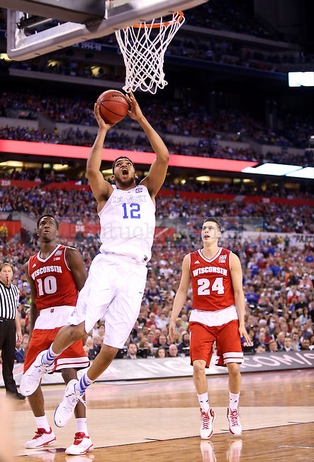 Center Karl-Anthony Towns of the Kentucky Wildcats shoots the ball during the game against the Wisconsin Badgers in the Final Four of the 2015 NCAA Men's Basketball Tournament at Lucas Oil Stadium on Saturday, April 4, 2015 in Indianapolis, In.  Photo by Jonathan Krueger | Staff.