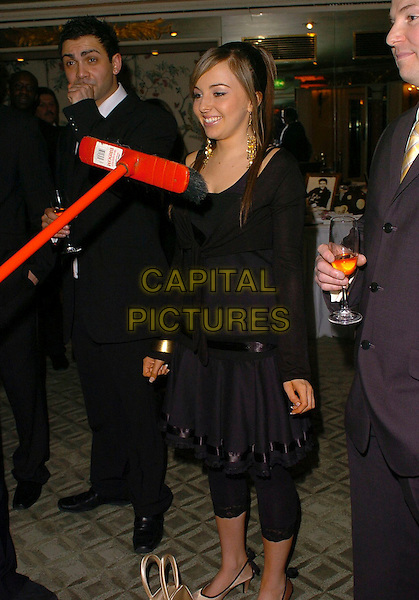 LOUISA LYTTON.The Chocolate Ball,.The Dorchester, London, England, .March 24th 2006..Full length funny broom.Ref: CAN.www.capitalpictures.com.sales@capitalpictures.com.©Capital Pictures
