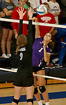 SIOUX FALLS, SD - SEPTEMBER 25: Shayla Johnson #1 from Dakota Valley tries to get a kill past Kensi Brands #9 from Sioux Falls Christian in the second game of their match Thursday night at Sioux Falls Christian High.  (Photo by Dave Eggen/Inertia)
