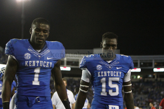 Martavius Neloms and J.D. Harmon hang their heads as they exit the field during the University of Kentucky football game against Western Kentucky University, at Commonwealth Stadium in Lexington, Ky., on Saturday September 15th. The Wildcats lost to WKU in overtime 32-31. Photo by Kirsten Holliday