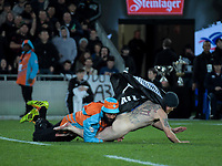 A streaker is tackled during the Steinlager Series international rugby match between the New Zealand All Blacks and France at Eden Park in Auckland, New Zealand on Saturday, 9 June 2018. Photo: Dave Lintott / lintottphoto.co.nz