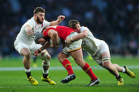 Jonathan Davies of Wales is double-tackled by Luke Cowan-Dickie and Jack Clifford of England. RBS Six Nations match between England and Wales on March 12, 2016 at Twickenham Stadium in London, England. Photo by: Patrick Khachfe / Onside Images