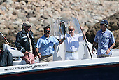 With former United States President George H.W. Bush, left, and U.S. President George W. Bush, right, looking on, President Vladimir Putin of Russia, right center, holds up his catch Monday, July 2, 2007, with the help of fishing guide Billy Bush, left center, during a morning outing at Walker's Point in Kennebunkport, Maine.  .Mandatory Credit: Eric Draper / White House via CNP