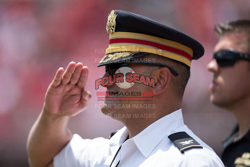 United States Army Colonel Morales salutes during the National Anthem prior to the game against the North Carolina State Wolfpack at Doak Field at Dail Park on June 3, 2018 in Raleigh, North Carolina. The Wolfpack defeated the Black Knights 11-1. (Brian Westerholt/Four Seam Images)
