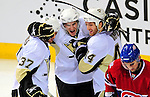 3 February 2009: Pittsburgh Penguins' left wing forward Luca Caputi (center) is congratulated by teammates Bill Thomas (37) and Brooks Orpik (44) after scoring in the first period against the Montreal Canadiens at the Bell Centre in Montreal, Quebec, Canada. The Canadiens defeated the Penguins 4-2. ***** Editorial Sales Only ***** Mandatory Photo Credit: Ed Wolfstein Photo