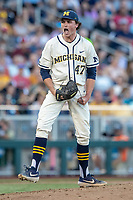 Michigan Wolverines pitcher Tommy Henry (47) celebrates after recording a key strikeout against the Vanderbilt Commodores during Game 1 of the NCAA College World Series Finals on June 24, 2019 at TD Ameritrade Park in Omaha, Nebraska. Michigan defeated Vanderbilt 7-4. (Andrew Woolley/Four Seam Images)