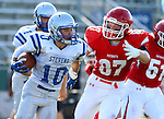 SIOUX FALLS, SD, AUGUST 27: Jamin Wurtz #10 from Rapid City Stevens tries to escape the grasp of Trent Naasz #87 from Sioux Falls Lincoln in the first half of their game Saturday night at Howard Wood Field. (Photo by Dave Eggen/Inertia)