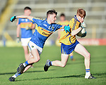 Shane Meehan of  Clare  in action against Eddie Daly of  Tipperary during their Munster Minor football semi-final at Thurles. Photograph by John Kelly.
