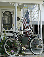 An old bike sits in front of a cottage Saturday, July 1, 2006, in Lakeside, Ohio.