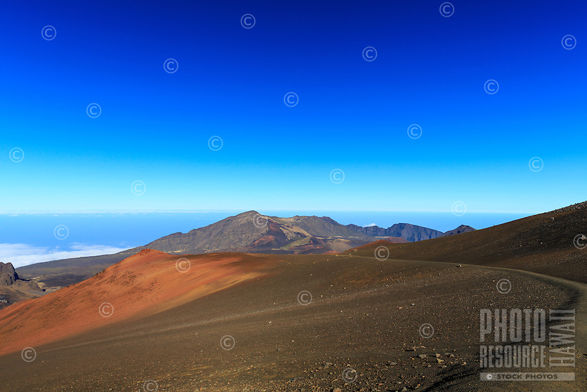 A hiker's view from along the Sliding Sands Trail in Haleakala reveals the magnificent and surreal scenery of Haleakala National Park, Maui.