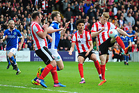 Lincoln City's Elliott Whitehouse lifts the ball over Macclesfield Town's Neill Byrne<br /> <br /> Photographer Andrew Vaughan/CameraSport<br /> <br /> Vanarama National League - Lincoln City v Macclesfield Town - Saturday 22nd April 2017 - Sincil Bank - Lincoln<br /> <br /> World Copyright &copy; 2017 CameraSport. All rights reserved. 43 Linden Ave. Countesthorpe. Leicester. England. LE8 5PG - Tel: +44 (0) 116 277 4147 - admin@camerasport.com - www.camerasport.com