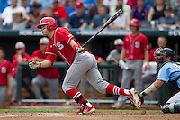 North Carolina State third baseman Grant Clyde (22) follows through on his swing during Game 3 of the 2013 Men's College World Series between the North Carolina State Wolfpack and North Carolina Tar Heels at TD Ameritrade Park on June 16, 2013 in Omaha, Nebraska. The Wolfpack defeated the Tar Heels 8-1. (Andrew Woolley/Four Seam Images)