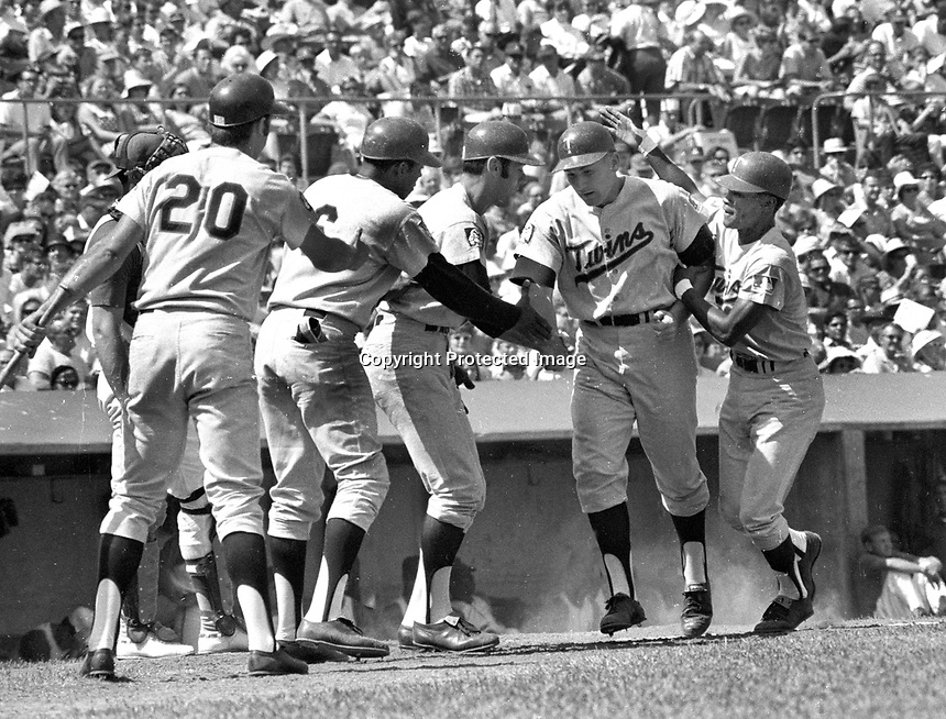 Minnesota Twins Harmon Killebrew congratulated at home after Grand Slam HR against the Oakland A's.<br />