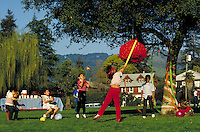 HISPANIC BOY AND FRIENDS WITH TOMATO PINATA PARTY. HISPANIC BOY AND FRIENDS. SAN FRANCISCO CALIFORNIA USA.