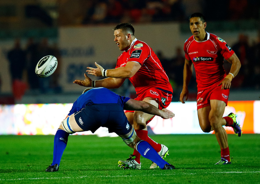 Scarlets' Rob Evans offloads<br /> <br /> Photographer Simon King/CameraSport<br /> <br /> Rugby Union - Guinness PRO12 - Scarlets v Leinster - Friday 16th October 2015 - The Liberty Stadium - Swansea<br /> <br /> &copy; CameraSport - 43 Linden Ave. Countesthorpe. Leicester. England. LE8 5PG - Tel: +44 (0) 116 277 4147 - admin@camerasport.com - www.camerasport.com